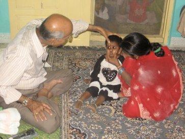 Dr.Lad_examining_child